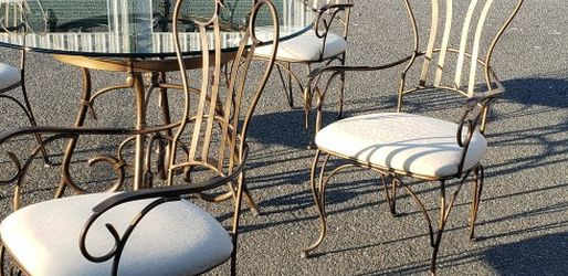 Wonderful Wrought Iron Table And Chairs . Excellent Condition. Heavy Glass Well Made for Sale in Ocala,  FL