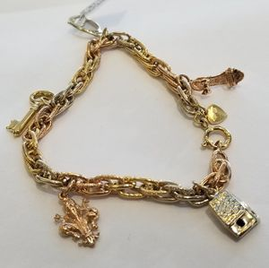 18k whote,rose and yellow gold bracelet with charms for Sale in San Diego, CA