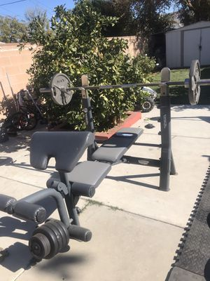 bench press with olympic bar and weights for Sale in Los Angeles, CA
