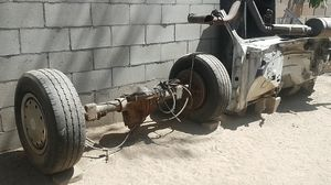 Chevy suburban parts < rear differential with tires (8 lugz), alternator , water pump ,hood ,transmission, wiring harness for Sale in DEVORE HGHTS, CA