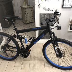 """Genesis 26"""" V2100 Men's Dual Suspension Mountain Bicycle. Aluminum Frame, 21 Speed, Front Disk Brake, The Bicycle is in Good Condition. for Sale in Orlando, FL"""