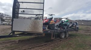 Very nice drive-on drive-off snowmobile trailer 4 long tracks or 6 four wheelers for Sale in Tooele, UT