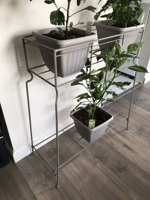 Grey metal plant stand with 2 shelves for Sale in Denver, CO