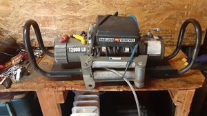 Badland winch 12000 pound with hitch receiver and about 30 feet of hot wire and ground wire good shape works good for Sale in Culpeper, VA