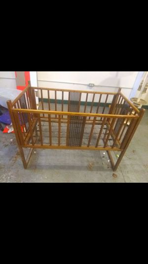 Beautiful antique crib, small maybe bassinet size needs 4 nuts for the connecting 4bolts. West York for Sale in York, PA