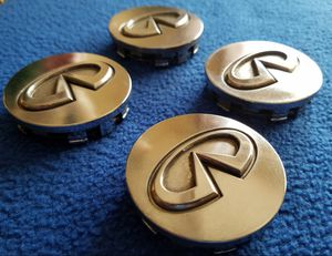 Genuine Infiniti Chrome Center wheel hupcaps set of (4). Excellent condition for Sale in Stanton, CA