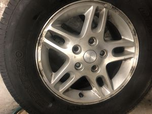 16 inch Jeep aluminum rim with like new tire. for Sale in Philadelphia, PA