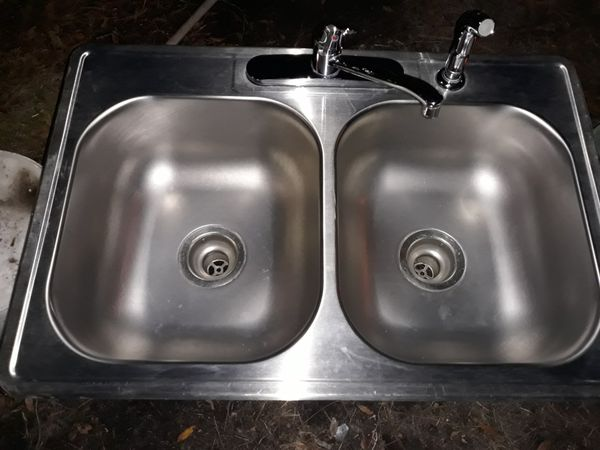 Stainless steel kitchen sink with faucets supply lines and drains