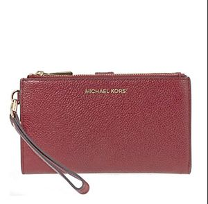 MICHAEL Michael Kors Adele Leather Smartphone Wristlet Maroon for Sale in Tampa, FL