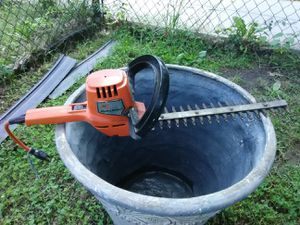 Black and Decker electric trimmer and Large Decorative Planting pot for Sale in Washington, DC