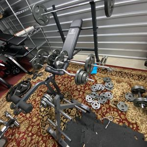 Ultimate Standard Bench Combo Deal 2 Barbells 2 Premium Handles Curl bar 265 pounds Plates 6 Peg Storage for Sale in Houston, TX