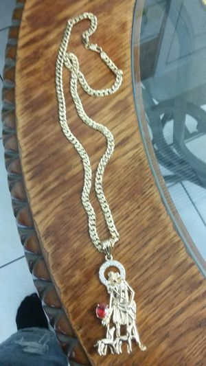 Very nice 14kt gold over stainless steel 26inch Cuban link Chain with nice San Lazaro charm for sale !! for Sale in Tampa, FL