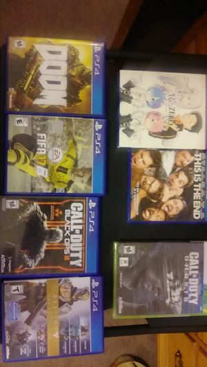 4 PS4 games 1 xbox 360 game 2 movies. for Sale in Apple Valley, CA