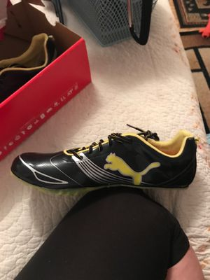 Puma size 15 running shoes with spikes never been worn for Sale in Lecompte, LA