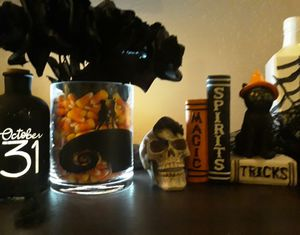 Nightmare Before Christmas. Candy corn filled (decoration only) glass vase with fake black roses. Almost 1 foot in length. for Sale in Ontario, CA