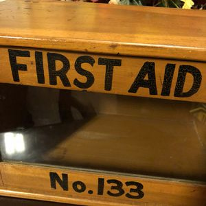 Antique vintage 16x9.5x10 FIRST AID wood and glass window box cabinet. Hinged door that opens. 110.00. 212 North Main Street. Buda 😀Johanna for Sale in Austin, TX
