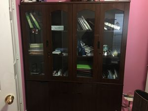 1 4 door hardwood bookshelves with keys to lock (paid $2500 for both), asking $1500 for Sale in Sugar Land, TX
