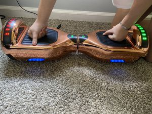 Rose gold LED hoverboard with Bluetooth speakers and charger included for Sale in Fayetteville, GA
