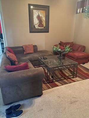 Micro suede sectional , coffee table, and chase, 2 years old. for Sale in Valrico, FL