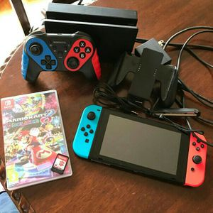Nintendo Switch plus two games and extra for Sale in Raleigh, NC