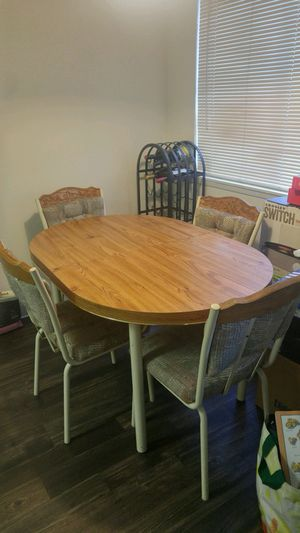 Table with six chairs and middle leaf (not in photo) for Sale in Bremerton, WA