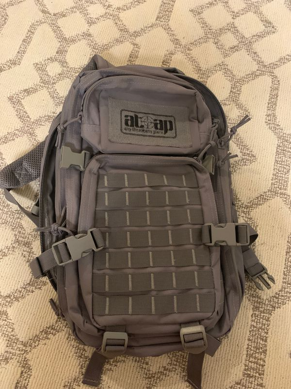 ATAP compact backpack with many straps and pockets