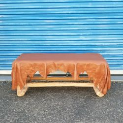 Southwest style coffee table or bench. Top is carved wood and resembles a draped leather hide. for Sale in Phoenix,  AZ
