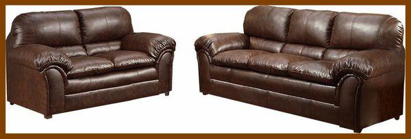 Burgundy sofa and love leather seat