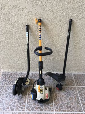 RYOBI GAS POWERED INTERCHANGEABLE LAWN EDGER & WEEDWHACKER. Small gas primer button will need to be replaced. I no longer cut my own grass. $50. for Sale in Kissimmee, FL