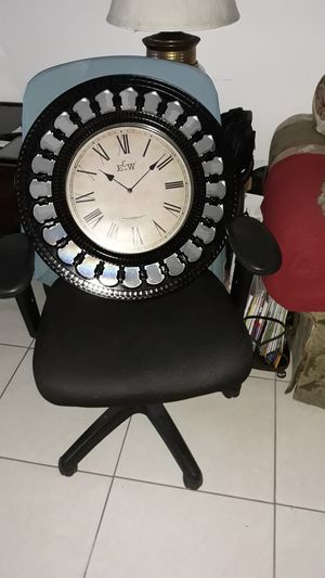 It is a black wall clock mirror with 23 mirrors around for $20.00. for Sale in Altamonte Springs, FL