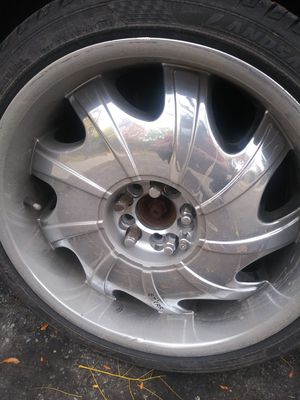 Luxury 20 inch rims..2 caps..need factory and money for rims..good tread tires and great rims..make a offer...or 500 cash for rims and tires for Sale in Indianapolis, IN