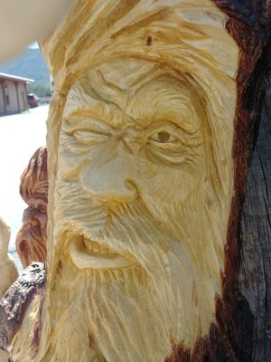 Pine Carving of Old Man in a tree winking for Sale in Payson, AZ