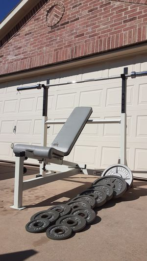 Key fitness bench press heavy duty with different positions comes with barbell and weights for Sale in Saginaw, TX