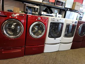 LG red electric front load set washer and dryer in great condition for Sale in McDonogh, MD