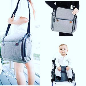 Diaper bag and booster seat 2 in 1 (only grey available) for Sale in Los Angeles, CA