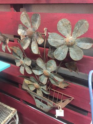 Metal art work. Flowers with pot. Great for outside!!! for Sale in Bandera, TX