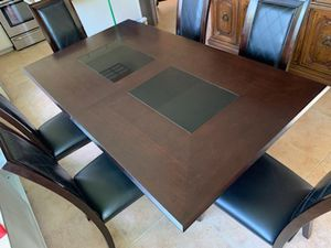 Wooden kitchen table with 2 opening 6 chairs and a leaf for Sale in Upland, CA