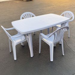 """New $80 Plastic Table Set and (4pcs) Armrest Chairs, Outdoor Patio Furniture, Table 54x33x28"""", Chairs 21x21x31"""" for Sale in Whittier,  CA"""
