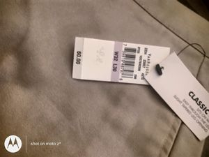 Van Heusen tan pants for men with tags still in never warn. for Sale in Sabina, OH
