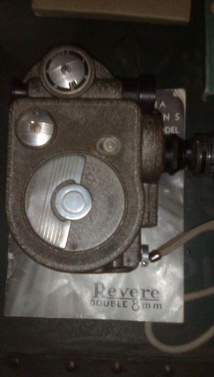 Revere double 8 mm camera and 8 mm old school cartoon reels for Sale in Stockton, CA