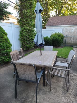 Table set with table, 6 chairs and umbrella 42 x 72 inches for Sale in Kings Point, NY