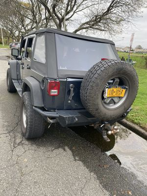 2008 Jeep Wrangler four-door Front and back camera and hitch for Sale in Freeport, NY
