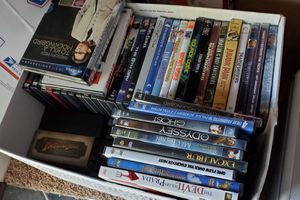Over 100 DVDs and player Excellent condition for Sale in Lacey, WA