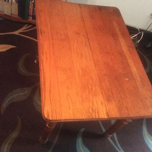 Antique solid oak table with porcelain castors for Sale in Pittsburgh, PA