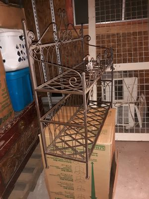 Steel storage rack. Use for magazines, shoes, workout equipment. Very good storage rack. for Sale in Rosenberg, TX