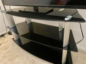 Glass tv stand with three shelves. In great condition! I will move to other country that why I am selling all my things. for Sale in Irvine, CA