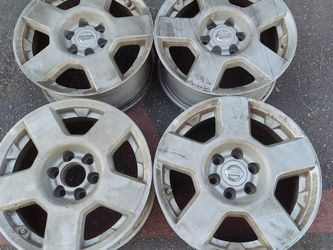 stock Nissan Frontier aluminum rims. 16 inch, 6 on 4.5 lugs for Sale in Pico Rivera,  CA