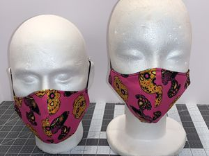 Pink Snoopy & Candy Skulls Reversible & Reusable Mask for Sale in Columbus, OH