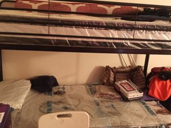 Twin Over Twin Bunk Bed Plastic Still On Mattresses for Sale in Milton,  MA
