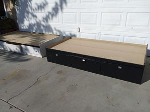 Twin size bed frame with 3 drawers under. $50 for the black $40 for the white... for Sale in Hanford, CA